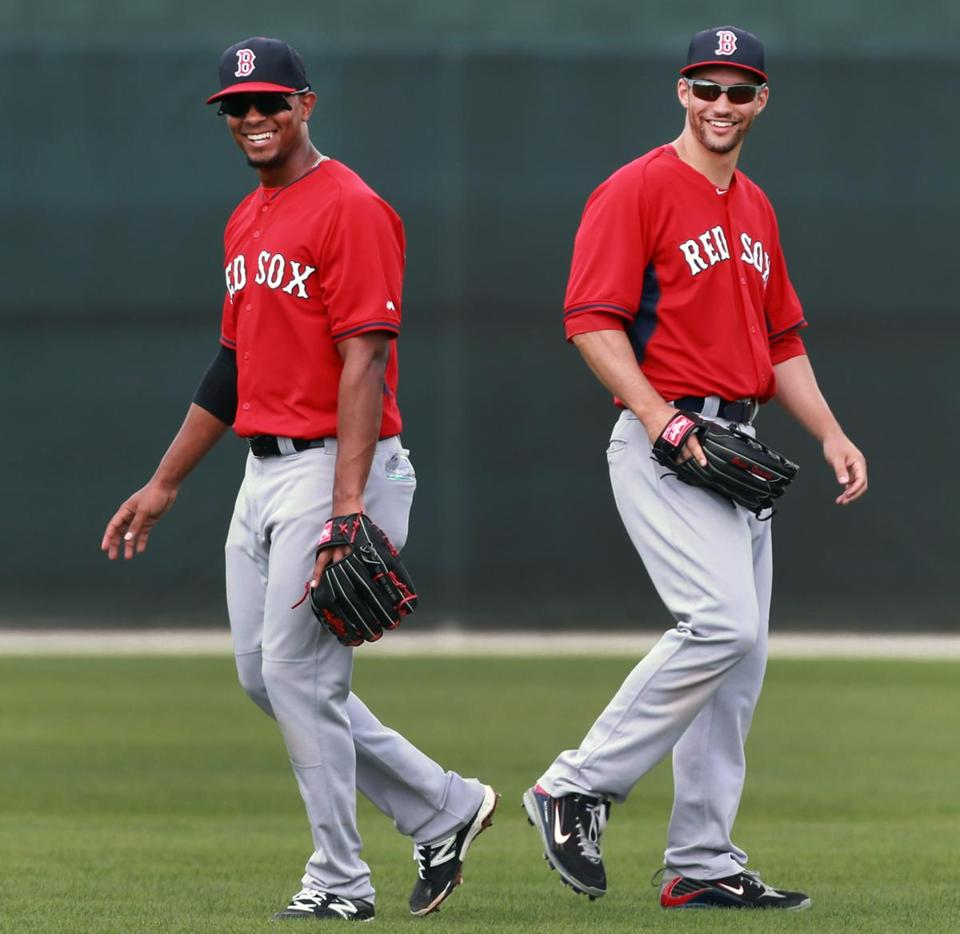 Rookie shortstop Xander Bogaerts (left) and veteran outfielder Grady Sizemore laugh during a popup drill.